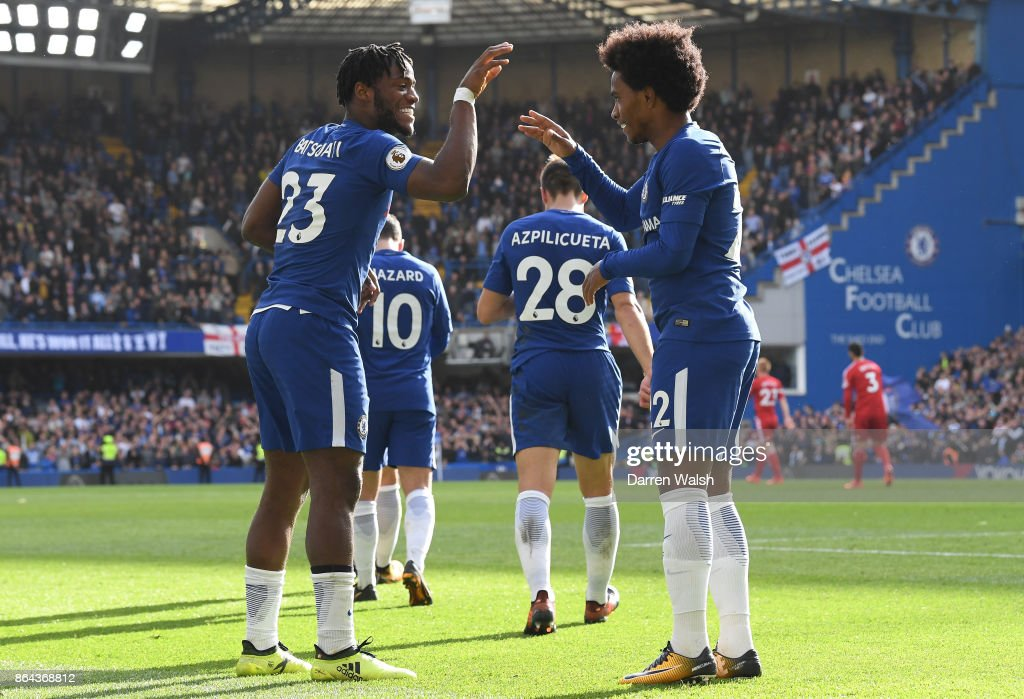Michy Batshuayi of Chelsea celebrates scoring his second goal, fourth goal for Chelsea with Willian during the Premier League match between Chelsea and Watford at Stamford Bridge on October 21, 2017 in London, England.