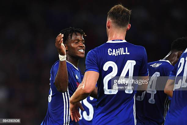Michy Batshuayi of Chelsea celebrates scoring the opening goal with Gary Cahill during the EFL Cup second round match between Chelsea and Bristol...