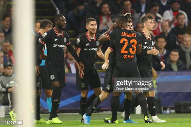 Michy Batshuayi of Chelsea celebrates with teammates after scoring his team's first goal during the UEFA Champions League group H match between AFC...