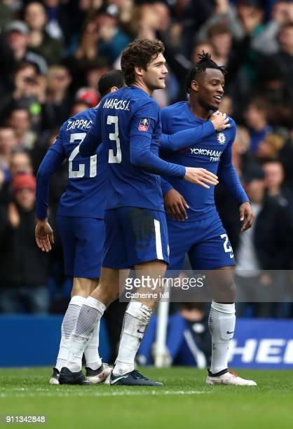 Michy Batshuayi of Chelsea celebrates with teammates Davide Zappacosta and Marcos Alonso after scoring his sides first goal during The Emirates FA...