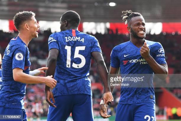 Michy Batshuayi of Chelsea celebrates with teammates Kurt Zouma and Jorginho of Chelsea after scoring his teams fourth goal the Premier League match...