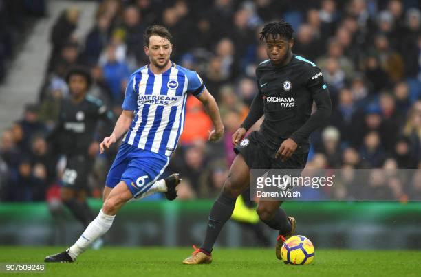 Michy Batshuayi of Chelsea controls the ball while under pressure from Dale Stephens of Brighton and Hove Albion during the Premier League match...