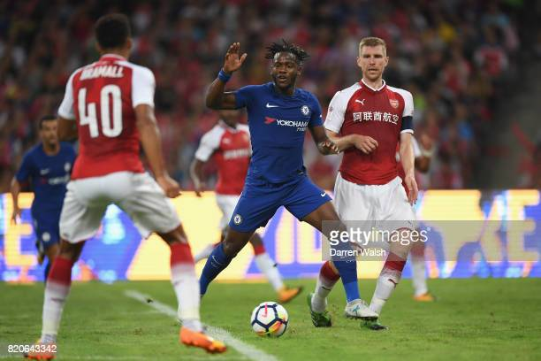 Michy Batshuayi of Chelsea gets away from Per Mertesacker of Arsenal during the PreSeason Friendly match between Arsenal FC and Chelsea FC at Birds...