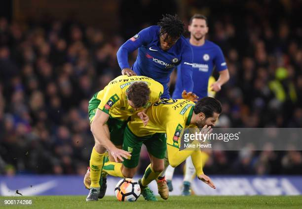Michy Batshuayi of Chelsea goes past Mario Vrancic of Norwich City and James Maddison of Norwich City during The Emirates FA Cup Third Round Replay...