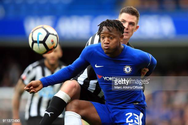 Michy Batshuayi of Chelsea in action with Ciaran Clark of Newcastle United during the FA Cup 4th Round match between Chelsea and Newcastle United at...