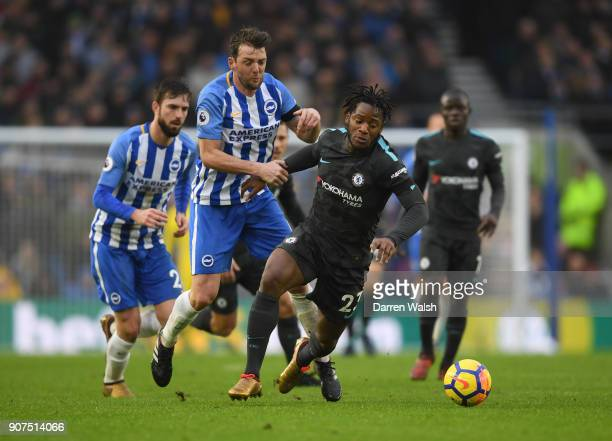 Michy Batshuayi of Chelsea is challenged by Dale Stephens of Brighton and Hove Albion during the Premier League match between Brighton and Hove...