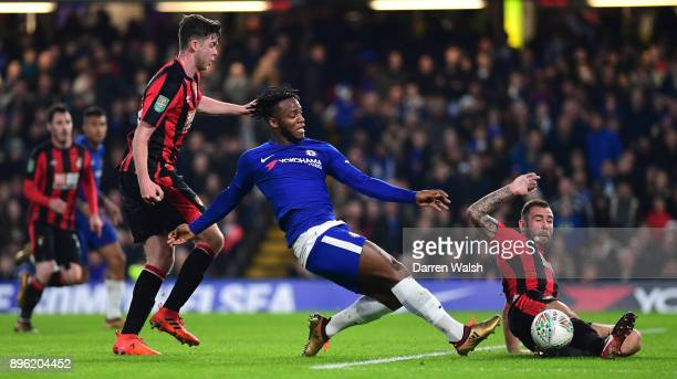 Michy Batshuayi of Chelsea is challenged by Jack Simpson and Steve Cook of AFC Bournemouth of AFC Bournemouth during the Carabao Cup QuarterFinal...