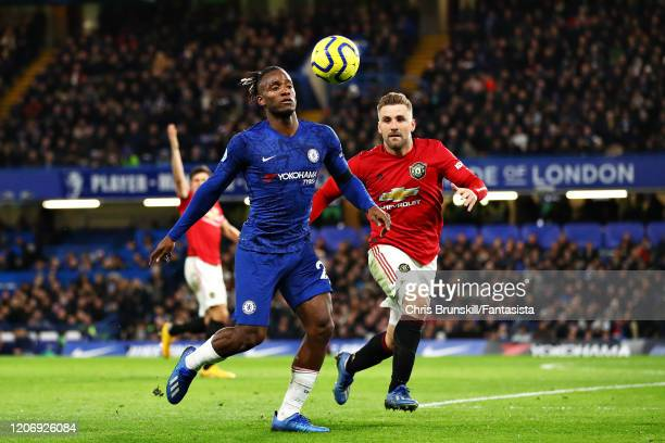 Michy Batshuayi of Chelsea is challenged by Luke Shaw of Manchester United during the Premier League match between Chelsea FC and Manchester United...