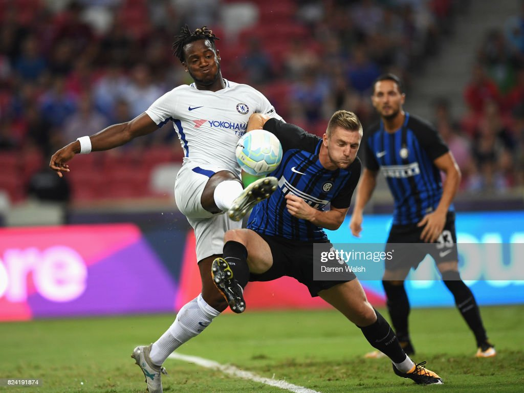 Michy Batshuayi of Chelsea is challenged by Milan Skriniar of Internazionale during the International Champions Cup match between FC Internazionale and Chelsea FC at National Stadium on July 29, 2017 in Singapore.