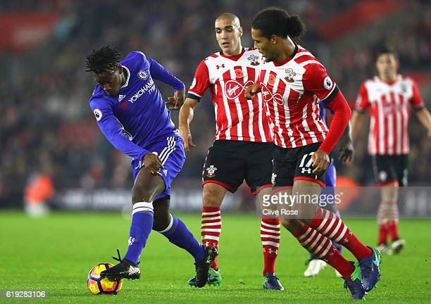 Michy Batshuayi of Chelsea is put under pressure from Virgil van Dijk of Southampton and Oriol Romeu of Southampton during the Premier League match...
