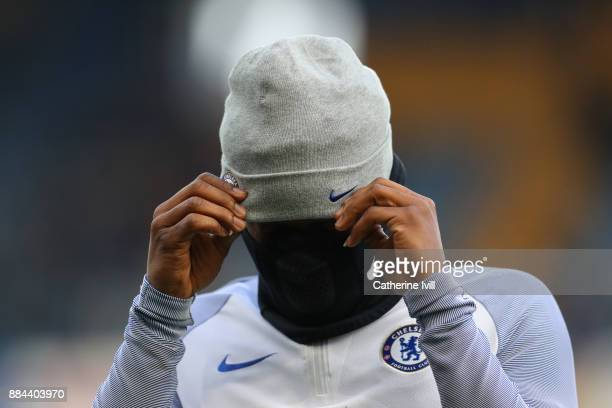 Michy Batshuayi of Chelsea is seen putting on a face mask prior to the Premier League match between Chelsea and Newcastle United at Stamford Bridge...