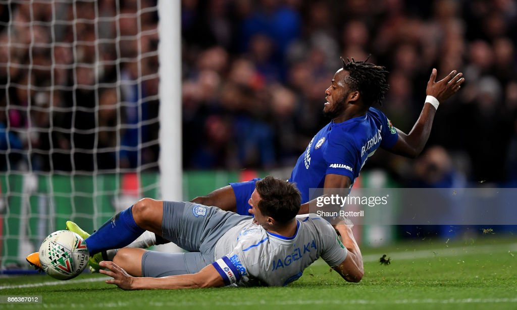 Michy Batshuayi of Chelsea is tackled by Phil Jagielka of Everton during the Carabao Cup Fourth Round match between Chelsea and Everton at Stamford Bridge on October 25, 2017 in London, England.