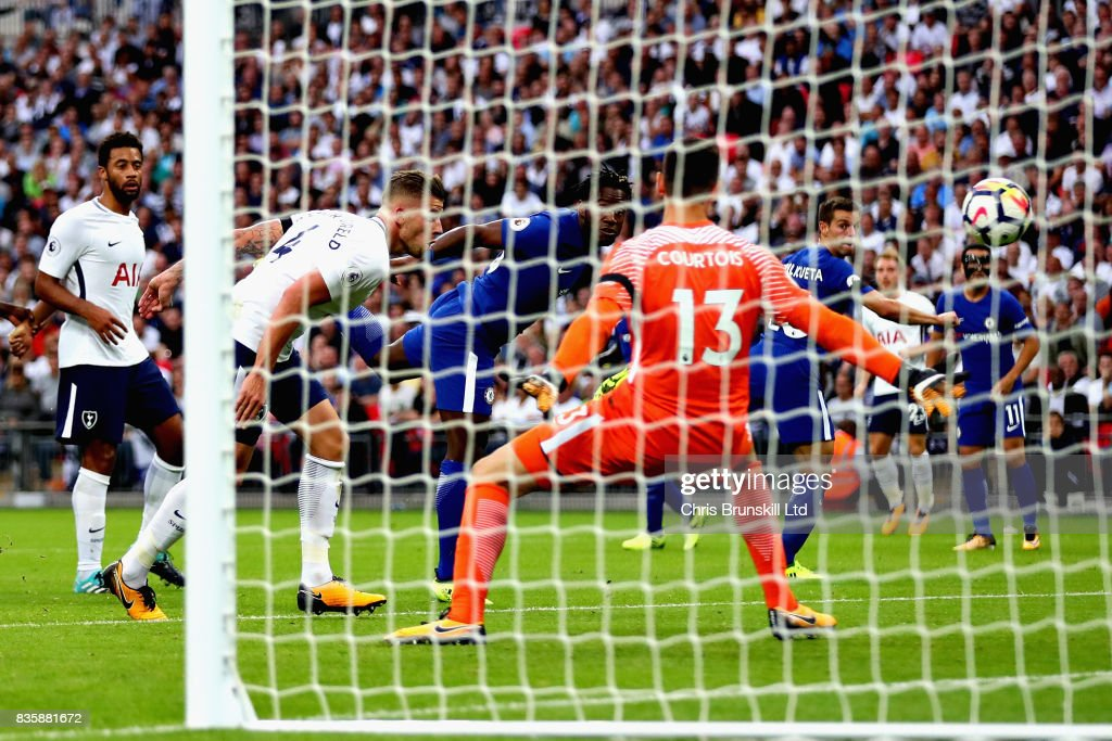 Michy Batshuayi of Chelsea scores an own goal during the Premier League match between Tottenham Hotspur and Chelsea at Wembley Stadium on August 20, 2017 in London, England.