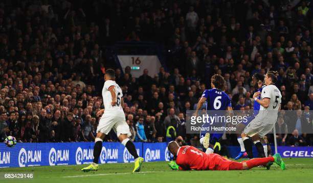 Michy Batshuayi of Chelsea scores his sides third goal past Heurelho Gomes of Watford during the Premier League match between Chelsea and Watford at...