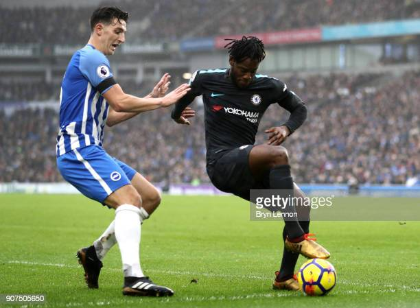 Michy Batshuayi of Chelsea shields the ball from Lewis Dunk of Brighton and Hove Albion during the Premier League match between Brighton and Hove...