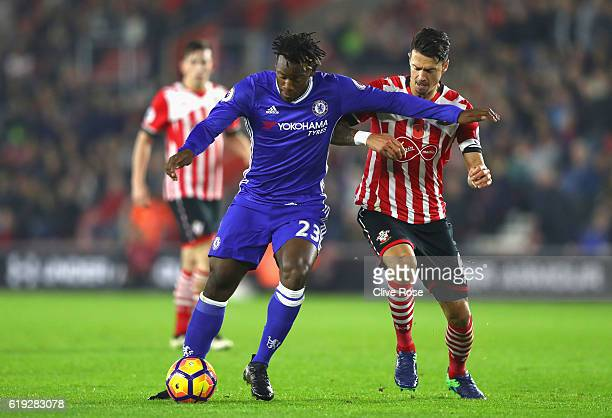 Michy Batshuayi of Chelsea shoots while Jose Fonte of Southampton puts pressure on him during the Premier League match between Southampton and...