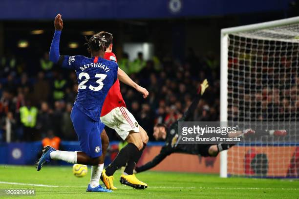 Michy Batshuayi of Chelsea takes a shot that goes wide of the goal during the Premier League match between Chelsea FC and Manchester United at...