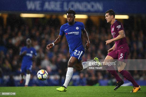 Michy Batshuayi of Chelsea takes the ball away from John Stones of Manchester City during the Premier League match between Chelsea and Manchester...