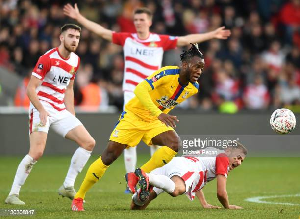 Michy Batshuayi of Crystal Palace battles with Herbie Kane of Doncaster Rovers during the FA Cup Fifth Round match between Doncaster Rovers and...