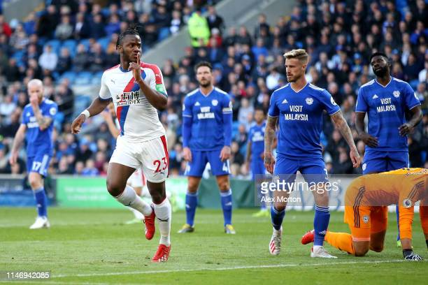 Michy Batshuayi of Crystal Palace celebrates after scoring his team's second goal during the Premier League match between Cardiff City and Crystal...