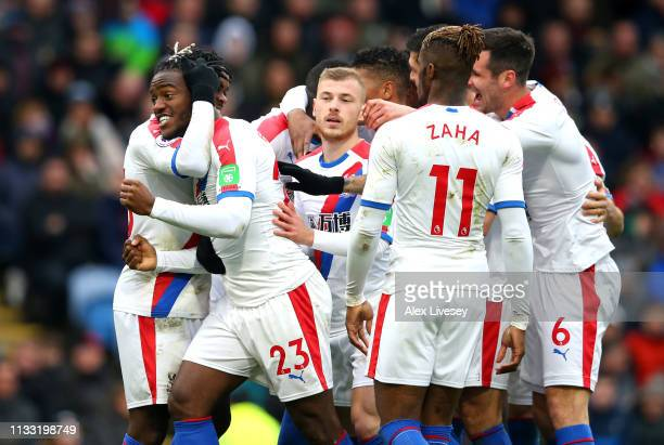 Michy Batshuayi of Crystal Palace celebrates with teammates after scoring his team's second goal during the Premier League match between Burnley FC...