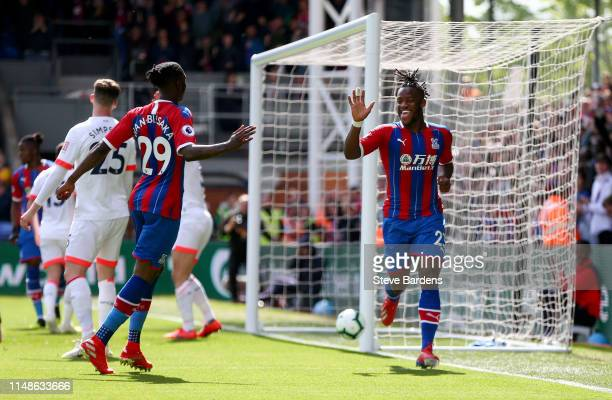 Michy Batshuayi of Crystal Palace celebrates with teammates after scoring his team's second goal during the Premier League match between Crystal...
