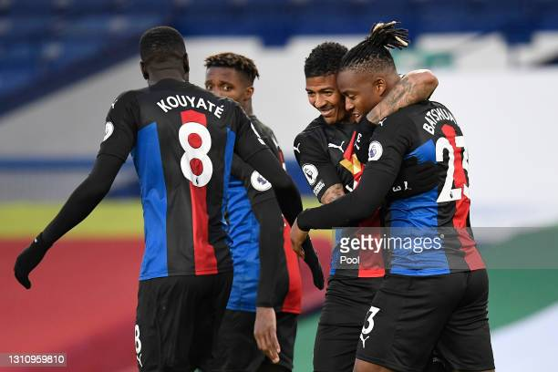 Michy Batshuayi of Crystal Palace celebrates with teammates Cheikhou Kouyate, Wilfried Zaha and Patrick van Aanholt after scoring their team's first...