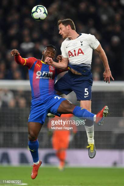 Michy Batshuayi of Crystal Palace challenges for the ball with Jan Vertonghen of Tottenham Hotspur during the Premier League match between Tottenham...