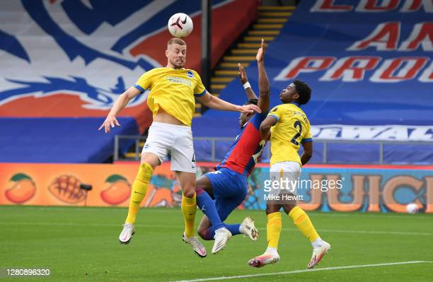 Michy Batshuayi of Crystal Palace is fouled by Adam Webster of Brighton and Hove Albion to concede a penalty during the Premier League match between...