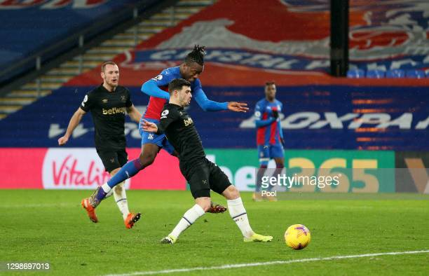 Michy Batshuayi of Crystal Palace scores their team's second goal while under pressure from Aaron Cresswell of West Ham United during the Premier...