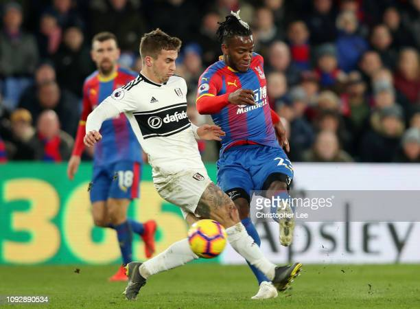 Michy Batshuayi of Crystal Palace shoots past Joe Bryan of Fulham during the Premier League match between Crystal Palace and Fulham FC at Selhurst...