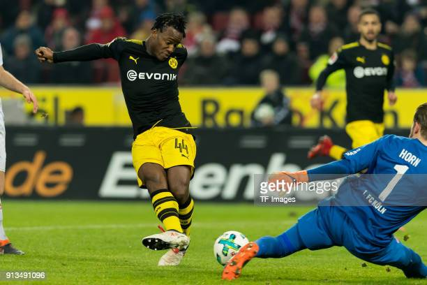 Michy Batshuayi of Dortmund and Goalkeeper Timo Horn of Koeln battle for the ball during the Bundesliga match between 1 FC Koeln and Borussia...
