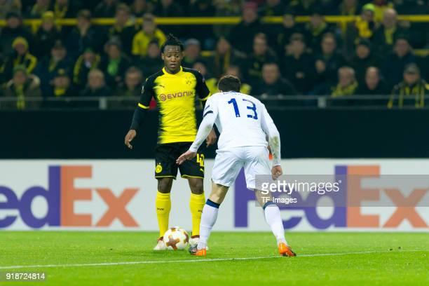 Michy Batshuayi of Dortmund and Mattia Caldara of Atalanta Bergamo battle for the ball during UEFA Europa League Round of 32 match between Borussia...