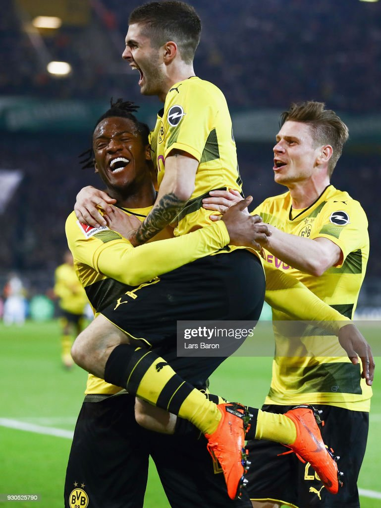 Michy Batshuayi of Dortmund celebrates his team's second goal with team mates Christian Pulisic and Lukas Piszczek during the Bundesliga match between Borussia Dortmund and Eintracht Frankfurt at Signal Iduna Park on March 11, 2018 in Dortmund, Germany.