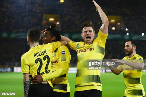 Michy Batshuayi of Dortmund celebrates his team's second goal with team mates Christian Pulisic Lukas Piszczek and Gonzalo Castro during the...