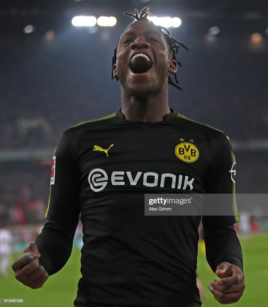 Michy Batshuayi of Dortmund celebrates scoring his second goal on his debut during the Bundesliga match between 1. FC Koeln and Borussia Dortmund at RheinEnergieStadion on February 2, 2018 in Cologne, Germany.