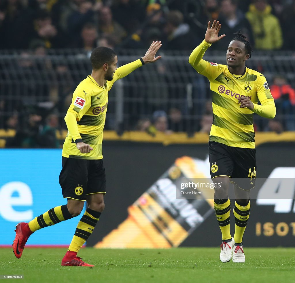 Michy Batshuayi of Dortmund (right) celebrates with his team after he scored a goal to make it 1:0 during the Bundesliga match between Borussia Dortmund and Hamburger SV at Signal Iduna Park on February 10, 2018 in Dortmund, Germany.