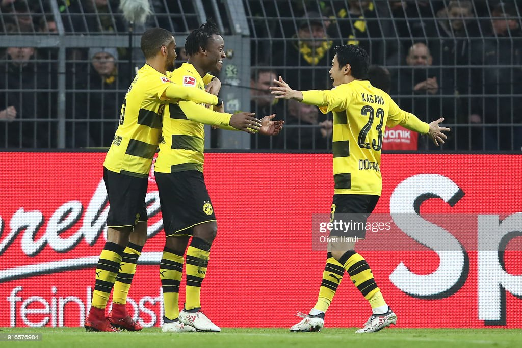 Michy Batshuayi of Dortmund (2nd left) celebrates with his team after he scored a goal to make it 1:0 during the Bundesliga match between Borussia Dortmund and Hamburger SV at Signal Iduna Park on February 10, 2018 in Dortmund, Germany.