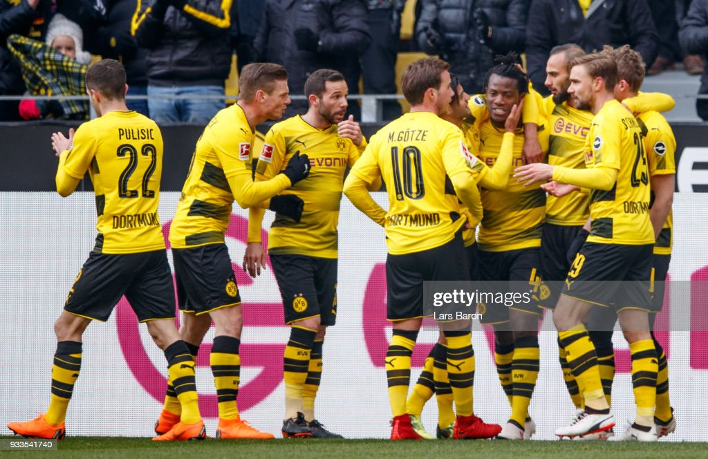 Michy Batshuayi of Dortmund celebrates with team mates after scoring his teams first goal during the Bundesliga match between Borussia Dortmund and Hannover 96 at Signal Iduna Park on March 18, 2018 in Dortmund, Germany.