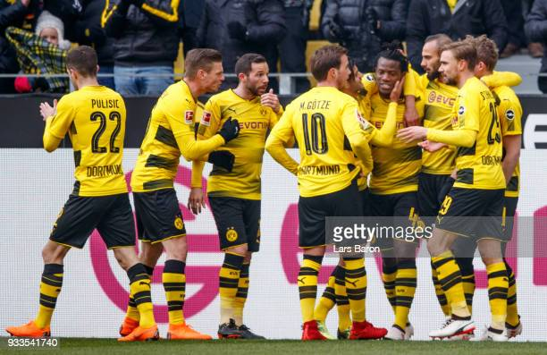Michy Batshuayi of Dortmund celebrates with team mates after scoring his teams first goal during the Bundesliga match between Borussia Dortmund and...