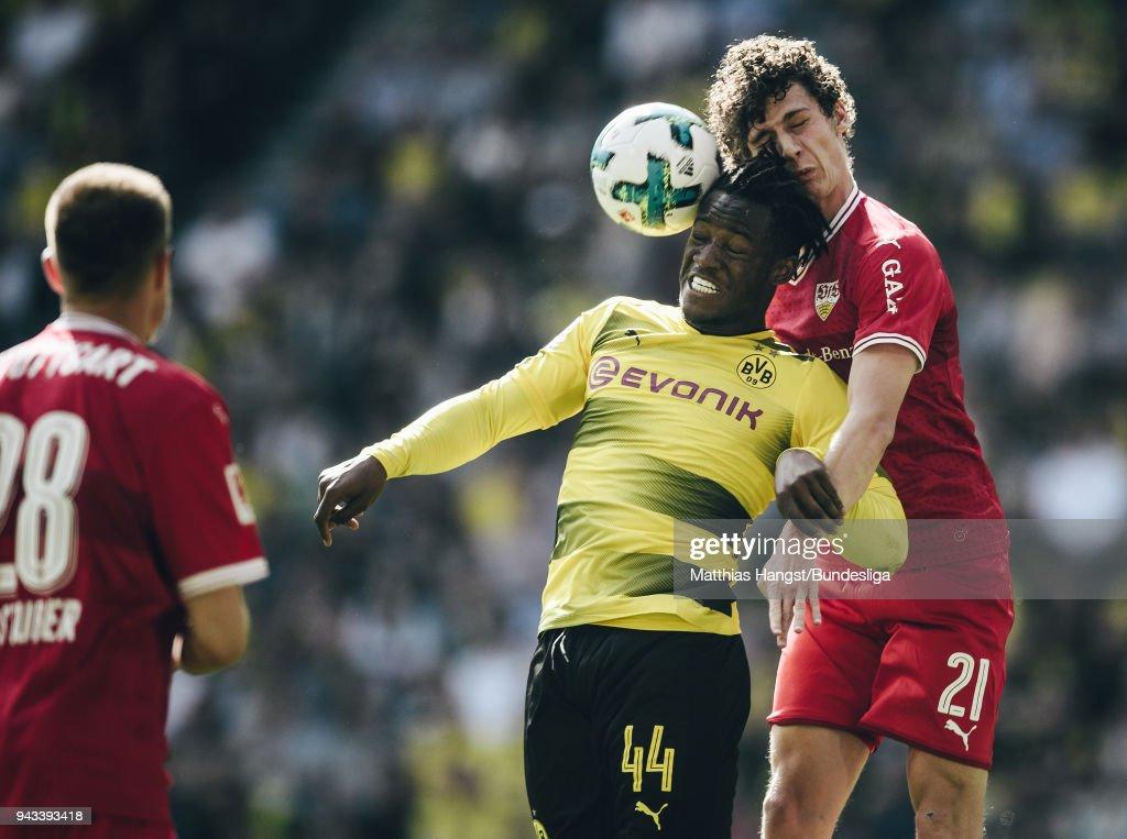 Michy Batshuayi of Dortmund jumps for a header with Benjamin Pavard of Stuttgart during the Bundesliga match between Borussia Dortmund and VfB Stuttgart at Signal Iduna Park on April 8, 2018 in Dortmund, Germany.