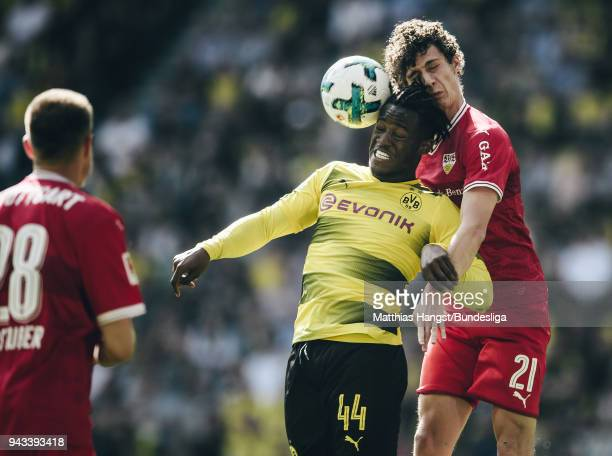 Michy Batshuayi of Dortmund jumps for a header with Benjamin Pavard of Stuttgart during the Bundesliga match between Borussia Dortmund and VfB...