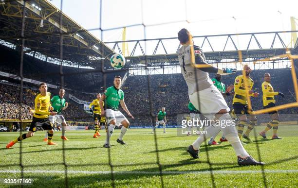 Michy Batshuayi of Dortmund scores his teams first goal during the Bundesliga match between Borussia Dortmund and Hannover 96 at Signal Iduna Park on...