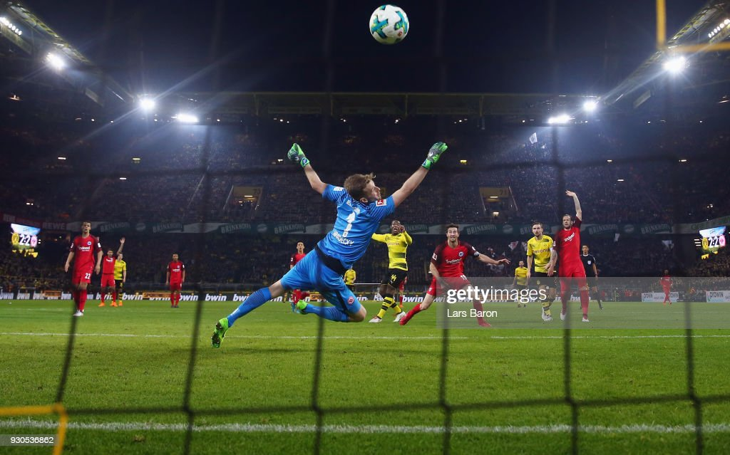 Michy Batshuayi of Dortmund scores his team's third goal against goalkeeper Lukas Hradecky of Frankfurt during the Bundesliga match between Borussia Dortmund and Eintracht Frankfurt at Signal Iduna Park on March 11, 2018 in Dortmund, Germany.