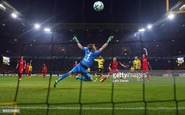 Michy Batshuayi of Dortmund scores his team's third goal against goalkeeper Lukas Hradecky of Frankfurt during the Bundesliga match between Borussia...