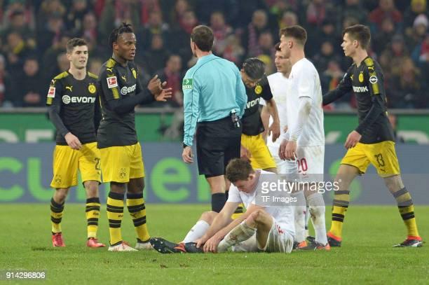 Michy Batshuayi of Dortmund speaks with Referee Benjamin Brand during the Bundesliga match between 1 FC Koeln and Borussia Dortmund at...