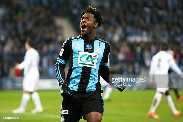 Michy Batshuayi of Marseille celebrates after scoring the first goal during the French Cup game between US Granville V Olympique de Marseille at...
