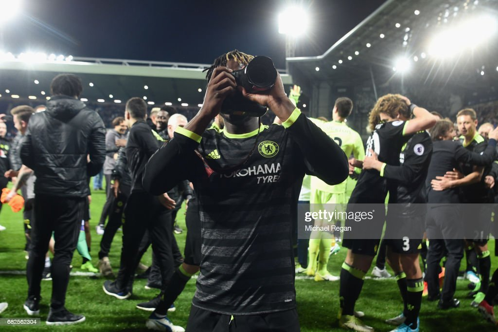 Michy Batshuayi takes pictures as Chelsea celebrate winning the league after the Premier League match between West Bromwich Albion and Chelsea at The Hawthorns on May 12, 2017 in West Bromwich, England. Chelsea are crowned champions after a 1-0 victory against West Bromwich Albion. Restrictions