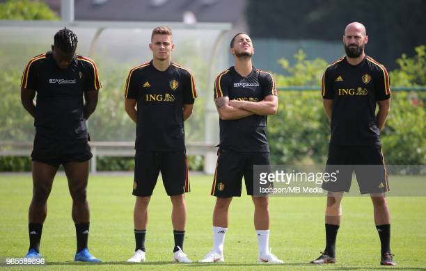 Michy BATSHUAYI Thorgan HAZARD Eden HAZARD and Laurent CIMAN respect a minute of silence before a training session of the Belgian national soccer...