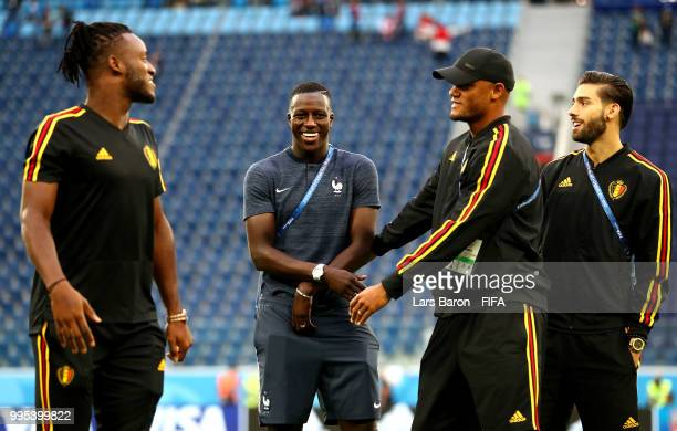 Michy Batshuayi Vincent Kompany and Yannick Carrasco of Belgium speak with Benjamin Mendy of France during a pitch inspection prior to the 2018 FIFA...